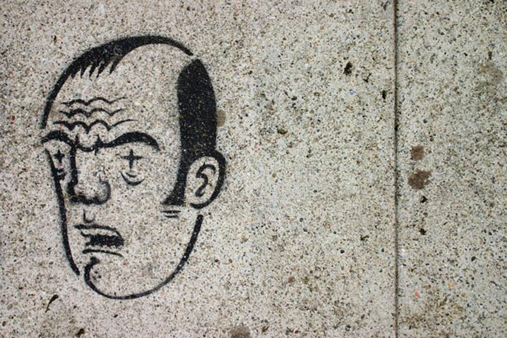 a sidewalk face, photographed by jeff michael