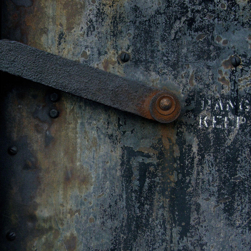 metal door detail with danger, keep out, photographed by louise häggberg