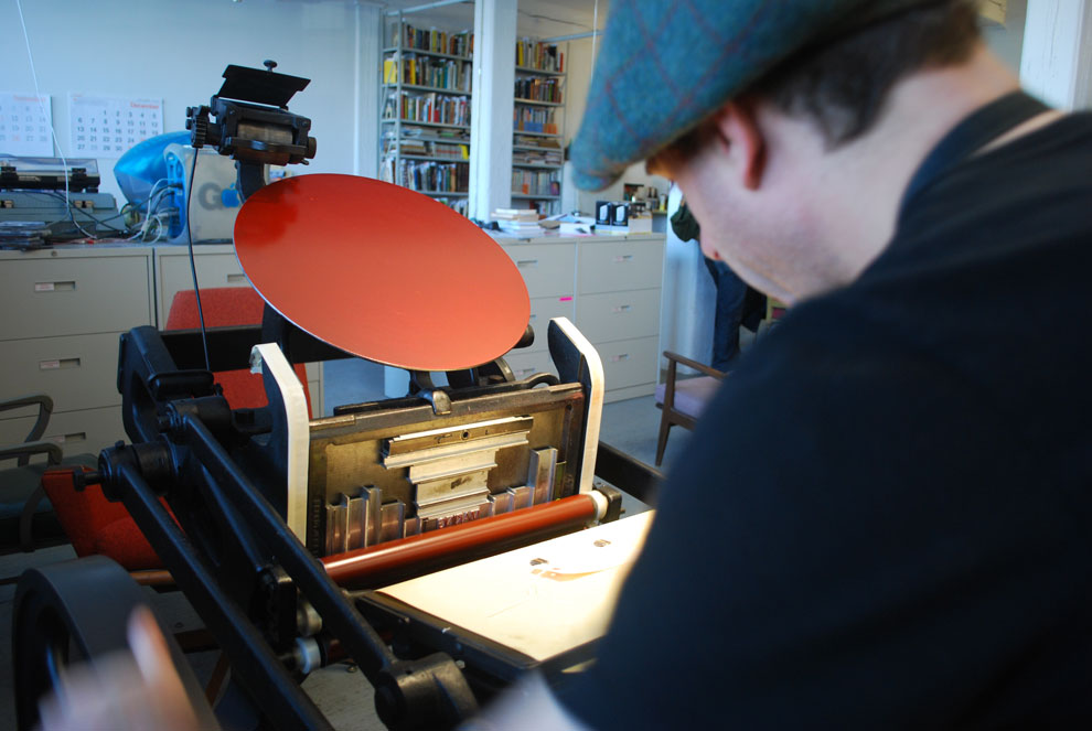 ben working on the chandler & price press, november 5, photographed by shannon miwa